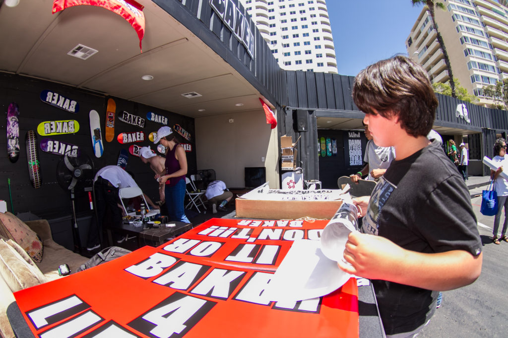 The Baker Boys were kicking it in their booth handing out huge posters stoking out their fans. Photo: Durso