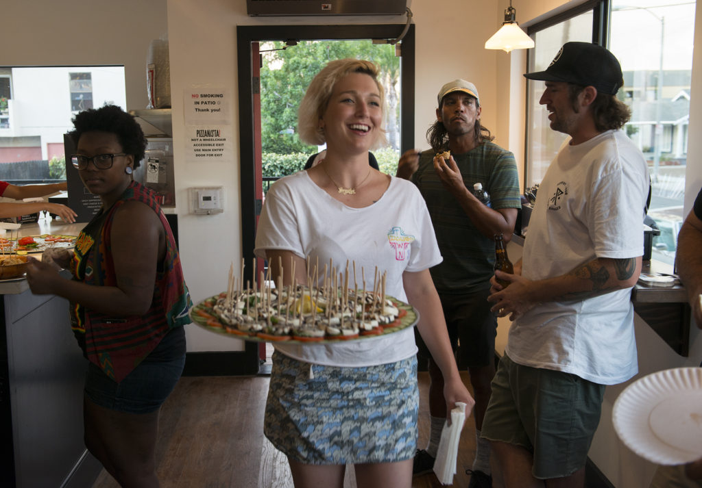 Smiles were on all the faces of the Pizzanista staff as they started things off with appetizers. Photo: Chami