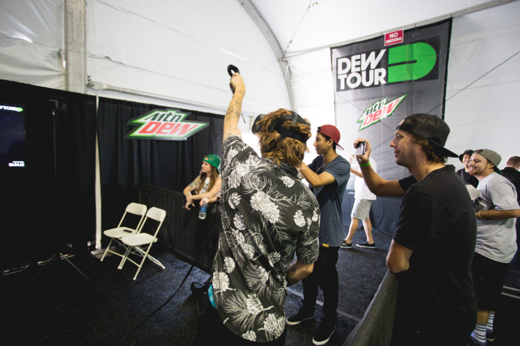 Nick Tucker along with other viewers are quick to draw out their phone to get Jordan Maxham on Snapchat while he gets artisanal in the VR world. Photo: Antal